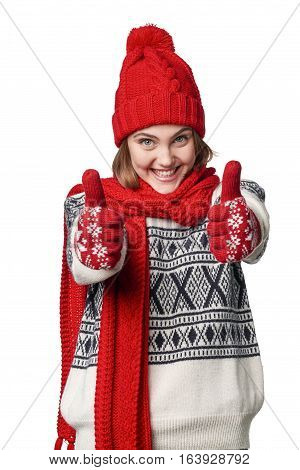 Excited winter warm clothing girl giving double thumb up, over white background