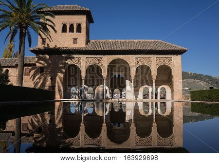 Alhambra Palace in Granada Spain palaces Nazaries, symmetrical reflection in the mirror of water