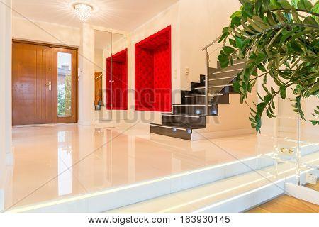 Luxurious modern villa interior with elegant stairs