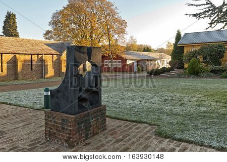 Hemel Hempstead England - November 2016: Photograph of a sculpture in front of the Abbot's door Amaravati Buddhist Monastery. Amaravati means 'the Deathless Realm'. The sculptor has been inspired by this subject.