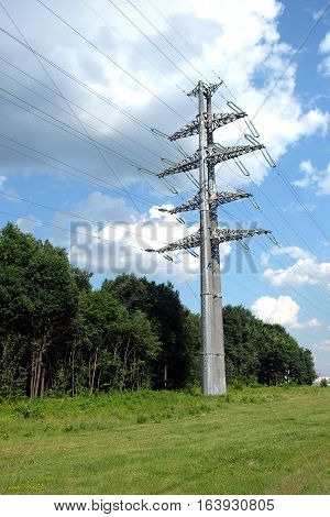 High-voltage power line gray metal prop with many wires vertical view closeup