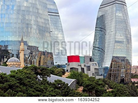 BAKU AZERBAIJAN - SEPTEMBER 25: Shahids mosque in front of Flame towers in Baku on September 25 2016. Baku is a capital and largest city of Azerbaijan.