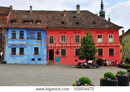 SIBIU ROMANIA - MAY 5: Central square of Sighisoara old town Romania on May 5 2016. Sibiu is the city located in Transylvania region of Romania.