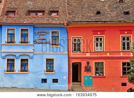 SIBIU ROMANIA - MAY 5: Facade of the hotel in Sighisoara old town Romania on May 5 2016. Sibiu is the city located in Transylvania region of Romania.