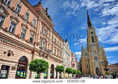 NOVI SAD SERBIA - MAY 13: People goes by the shopping street in Novi Sad city Serbia on May 13 2016. Novi Sad is the second largest city of Serbia.