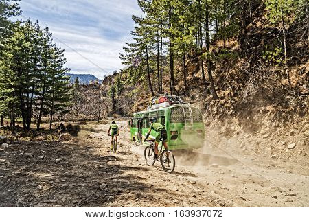 Mountain biking in Nepal. Two men riding bikes. Mountain biking on Annapurna high mountain region.