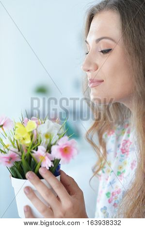 beautiful young woman with flowers, close up