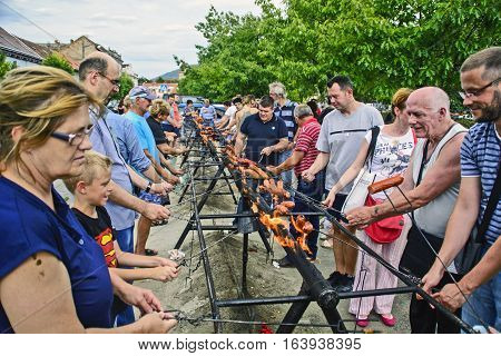 Vrsac Serbia September 17 2016.The traditional street roast sausage on fire during the manifestations.