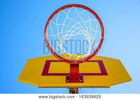 Basketball hoop net rim on a blue sky background