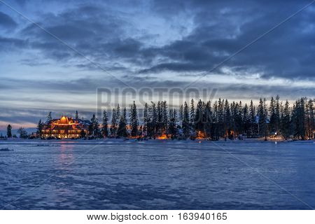 Winter in High Tatras Mountains. High Tatry. Slovakia. Vysoke Tatry. Frozen lake winter trees.