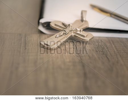 The Silver Crucifix And A Pen On The A Blank Note Book,christian Concept