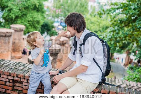 Father And Toddler Son Tourists In Ventname. Po Nagar Cham Tovers. Asia Travel Concept.
