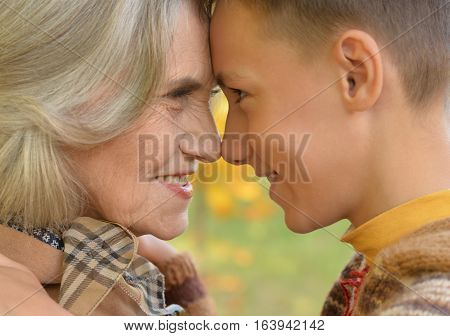 Portrait of a grandmother with her grandson, close up