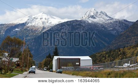 The panoramic view of Alaska Street alongside an airport in Skagway town (Alaska).
