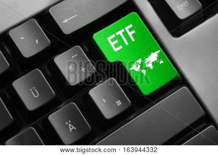 grey keyboard with green enter key etf international trading