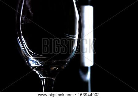 Vintage crystal champagne cup over black background