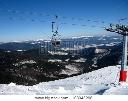 The chair ski lift in the ski resort high in the mountains