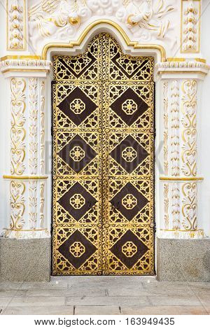 The door to the Cathedral of the Assumption of the Kiev-Pechersk Lavra. The famous monastery included in UNESCO world heritage
