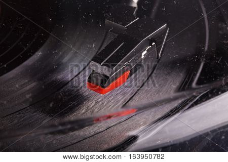 Turntable head seen through a dusty glass horizontal image