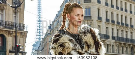 Portrait Of Modern Fashion-monger In Fur Coat In Paris, France