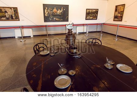 MIRZAANI, GEORGIA - OCT 7, 2016: Paintings and retro furniture inside the house-museum of the painter Niko Pirosmani where he lived last years on October 7, 2016. Georgian primitivist lived in 1862-1918