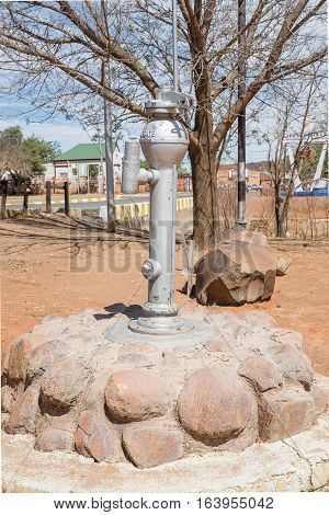 KOFFIEFONTEIN SOUTH AFRICA - DECEMBER 24 2016: An historic coin-operated water pump in Koffiefontein (coffee fountain) a diamond mining town in the Free State Province