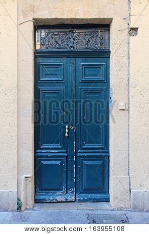 Exterior of closed demolished old wooden door