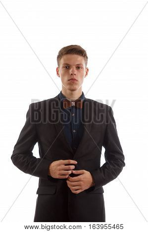 A man buttoning his jacket on white background