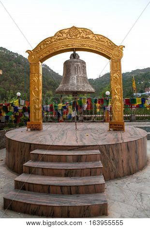 REWALSAR, INDIA. 2 June 2009:   Buddhist prayer bell in Rewalsar. Rewalsar, district Mandi, Himachal Pradesh, district of Kangra, India.