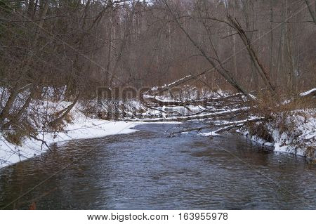 river in winter forest beautiful background with snow