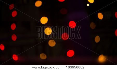 Red Bokeh lights. Beautiful Christmas background. Christmas and New Year. Christmas light background Festive abstract background with golden light bokeh
