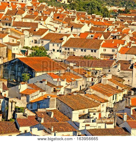 red tile roofs in european medieval village, square toned image