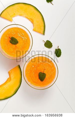 Homemade Cantaloupe Melon Smoothie Drink. Selective focus.