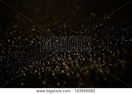 Drops of rain on window with abstract lights. Rain drops on window with road light bokeh, City life in night in rainy season abstract background, water drop on the glass, night storm raining car driving concept.