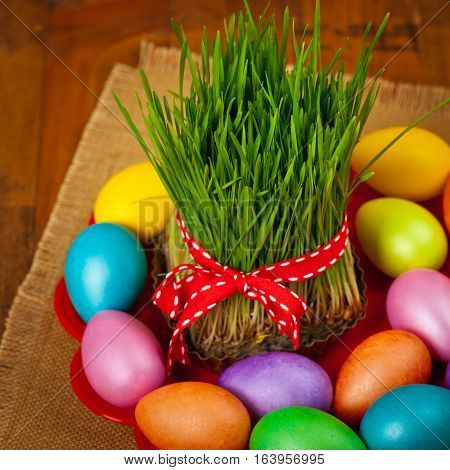 Colored eggs, wheat springs Nowruz Holiday in Azerbaijan. Selective focus. poster