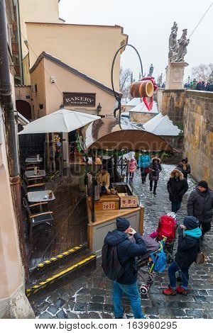 PRAGUE, CZECH REPUBLIC - 03.01.2017: Bakery with czech traditional sweet dessert called trdelnik on the street in the old town of Prague Czech Republic