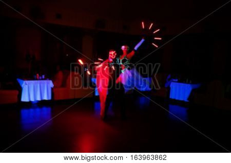 Diode Light Show Artists On Wedding Party. Blured Photo.