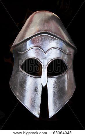 Metal medieval helmet armour isolated on black background