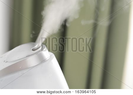 Baby room air humidifier puffing steam indoors