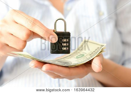 Secure your savings concept with cipher lock and money