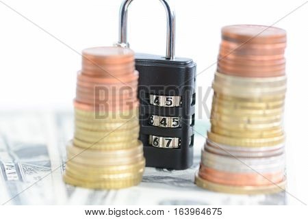 Saving protection concept with money and combination lock