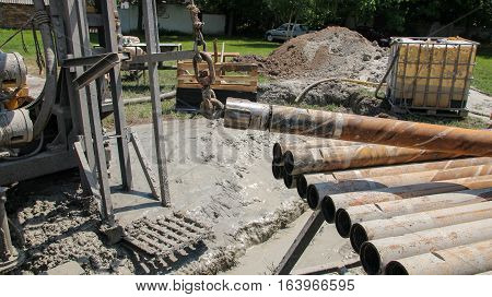 Lifting Drill Pipe On Core Drilling Platform. Drill Pipe on Drilling Rig.