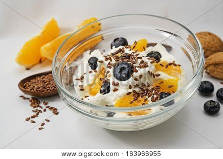 Quark yogurt or cottage cheese flax seeds and fresh fruits aug a light gray background healthy diet for digestion closeup with selected focus narrow depth of field
