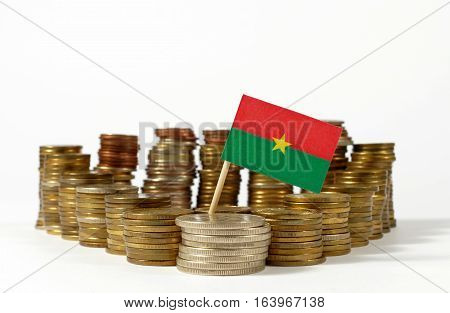 Burkina Faso Flag Waving With Stack Of Money Coins