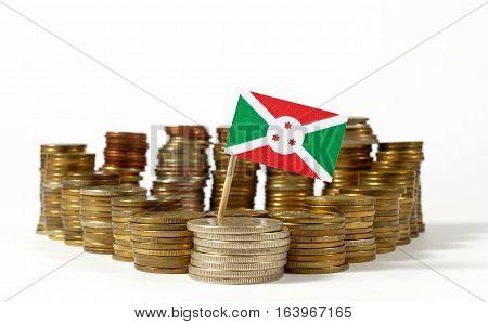 Burundi Flag Waving With Stack Of Money Coins