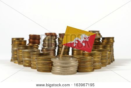 Bhutan Flag Waving With Stack Of Money Coins