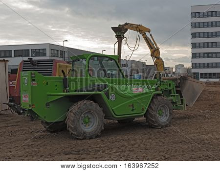 RAUNHEIM, KELSTERBACH, GERMANY-JANUARY 03, 2027: Green telescopic loader on a construction site