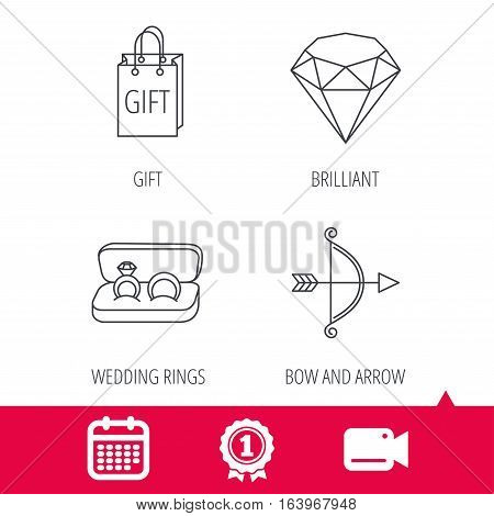 Achievement and video cam signs. Brilliant, gift and wedding rings icons. Bow and arrow linear signs. Calendar icon. Vector