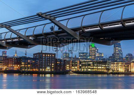 London, England - June 17 2016: Night Photo of Thames River and Millennium Bridge, London, Great Britain