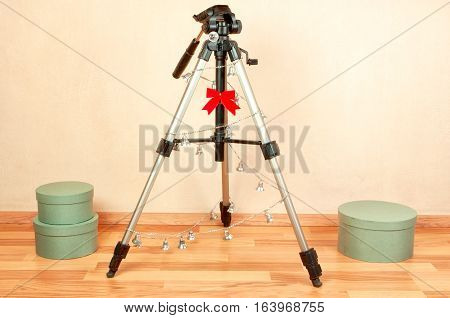 Tripod with Christmas decorations, Christmas tree for photographers